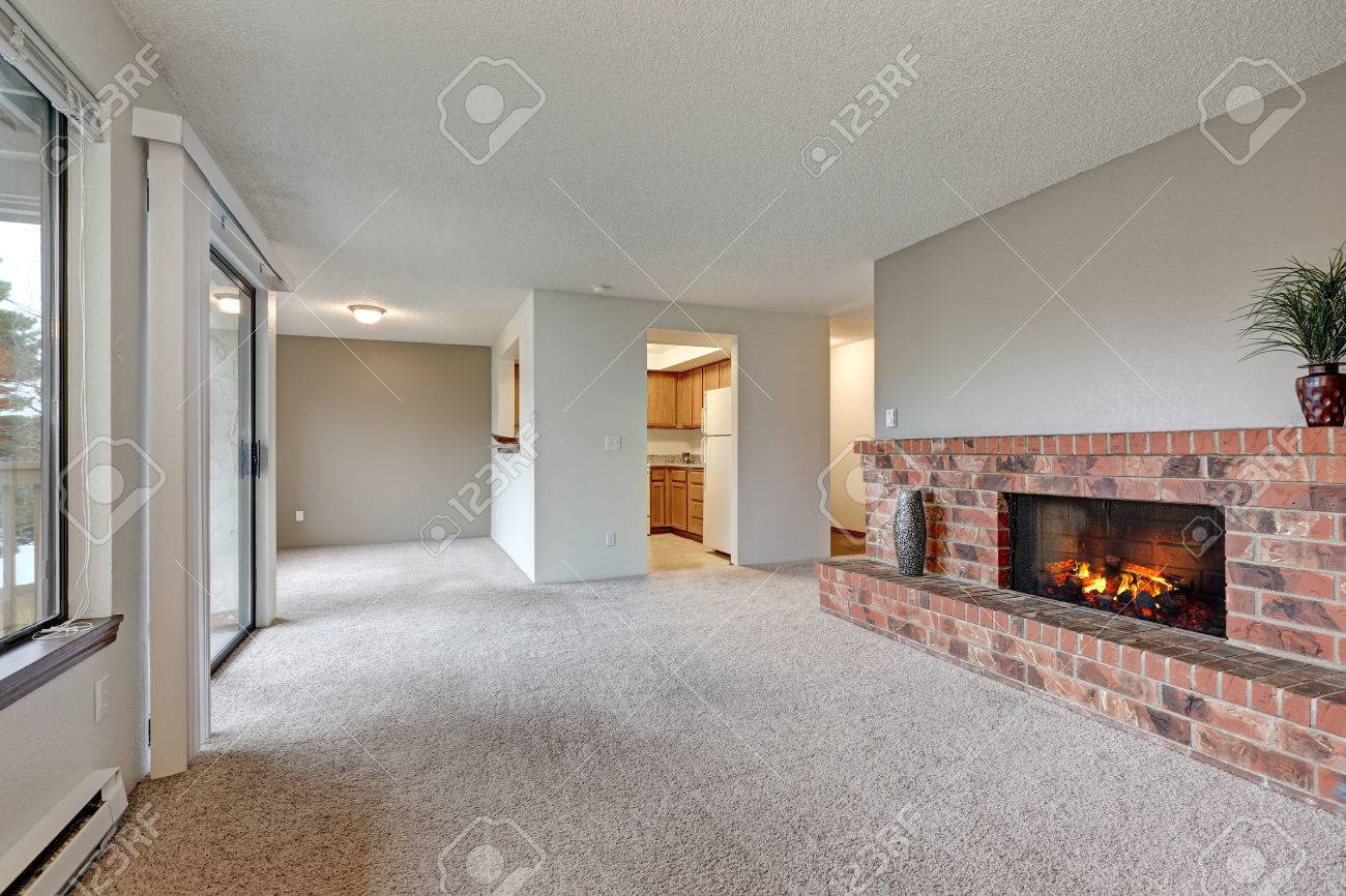 Empty Living Room Features White Walls Carpet Floor And Red Stock Photo Picture And Royalty Free Image Image 72480479