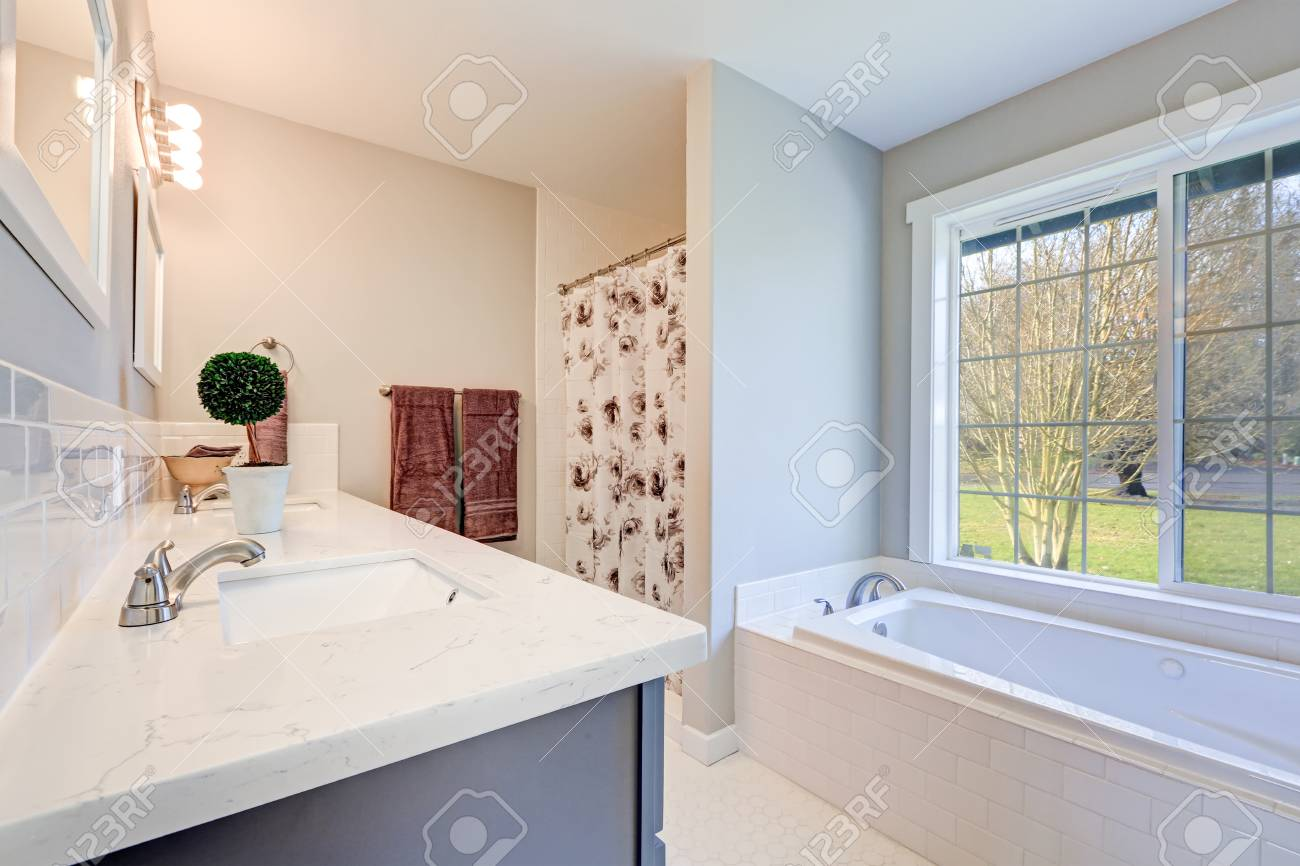 Light Filled Bathroom Interior Accented With Double Sink Blue Stock Photo Picture And Royalty Free Image Image 72437172
