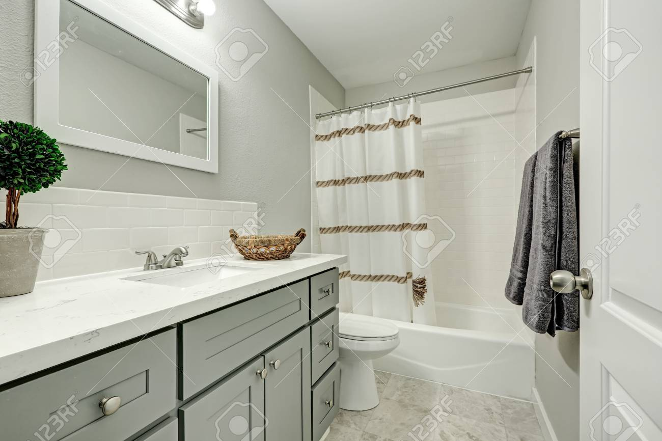 - New Bathroom Interior Boasts Silver Grey Vanity Cabinet Topped