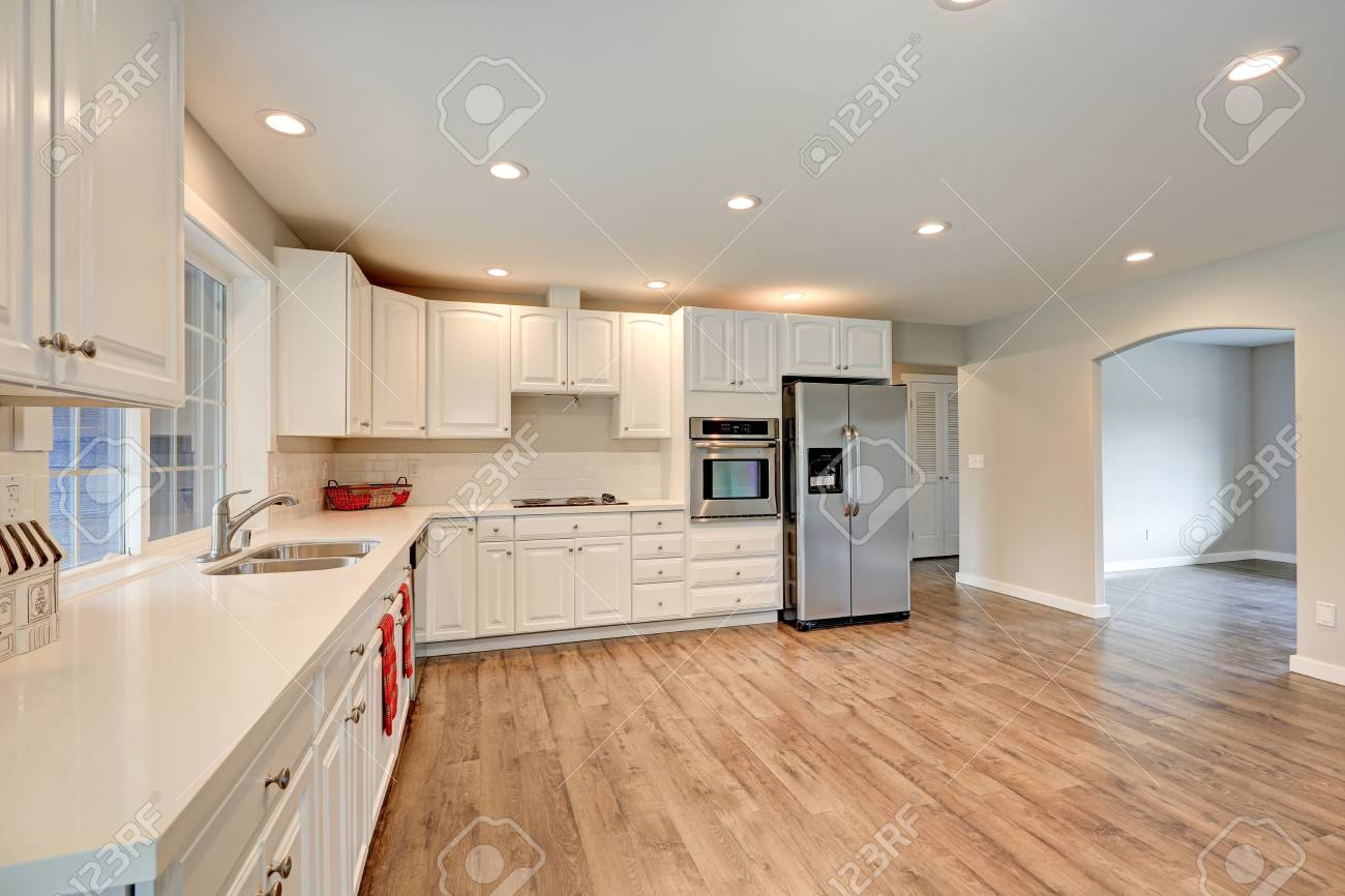 New Light Filled Kitchen Room Boasts White Cabinets Quartz Countertops Stock Photo Picture And Royalty Free Image Image 72480995