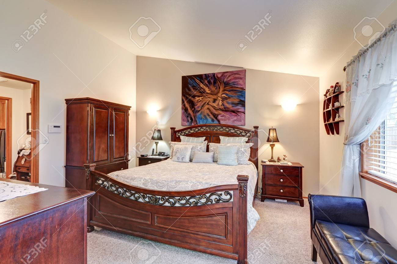 Chic Master Bedroom Features Vaulted Ceiling Over Gorgeous Wood Stock Photo Picture And Royalty Free Image Image 72476882