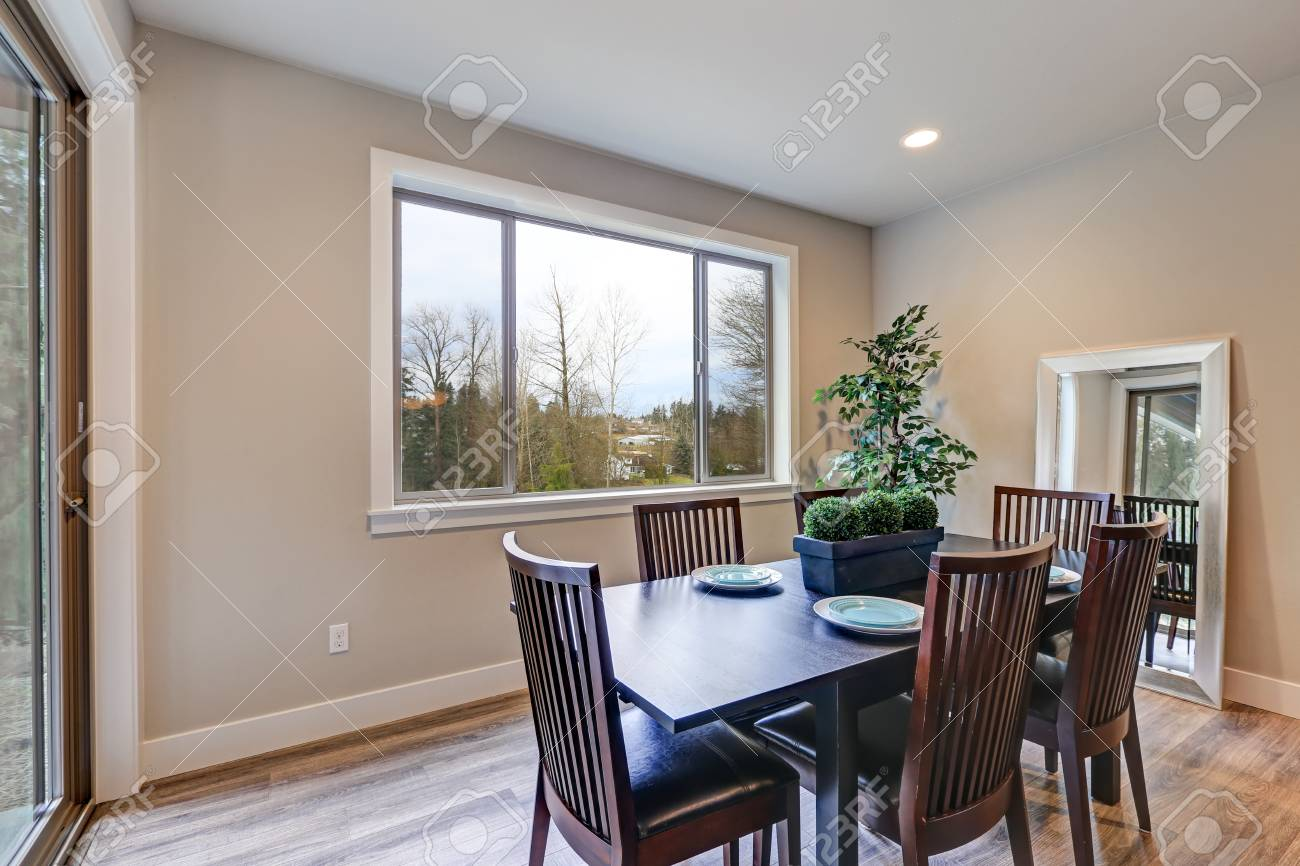Neutral Dining Room Interior Fitted With Black Dining Table Lined Stock Photo Picture And Royalty Free Image Image 72526289