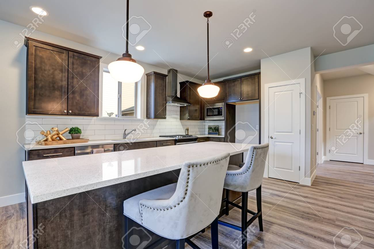 - New Kitchen Boasts Dark Wood Cabinets, White Backsplash Subway