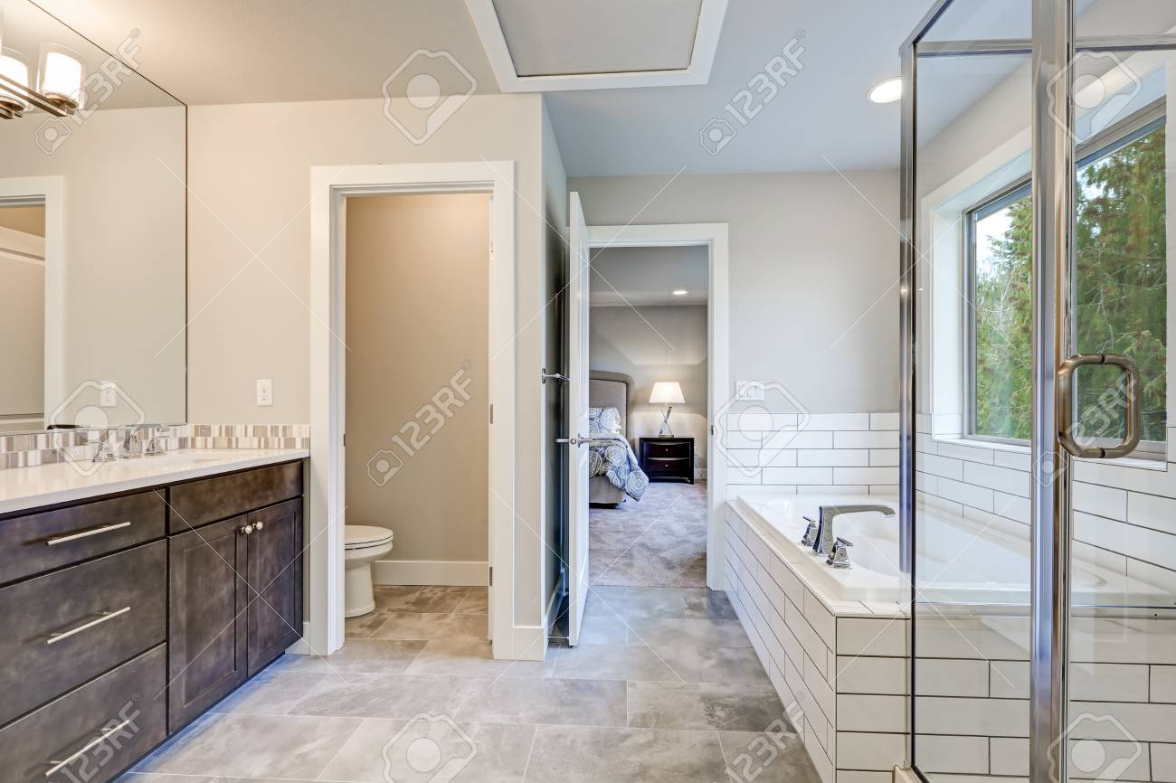 Gorgeous Bathroom Interior Boasts Drop-in Tub With White Tile ...