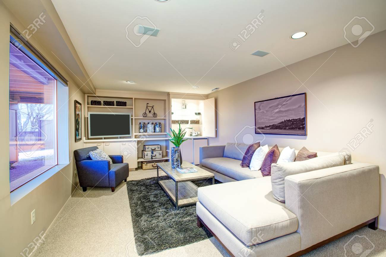 Astonishing Welcoming Living Room Features Light Beige Sectional Facing Industrial Lamtechconsult Wood Chair Design Ideas Lamtechconsultcom