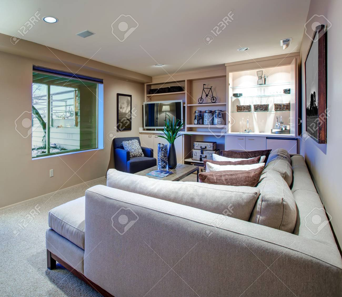 Strange Welcoming Living Room Features Light Beige Sectional Facing Industrial Lamtechconsult Wood Chair Design Ideas Lamtechconsultcom