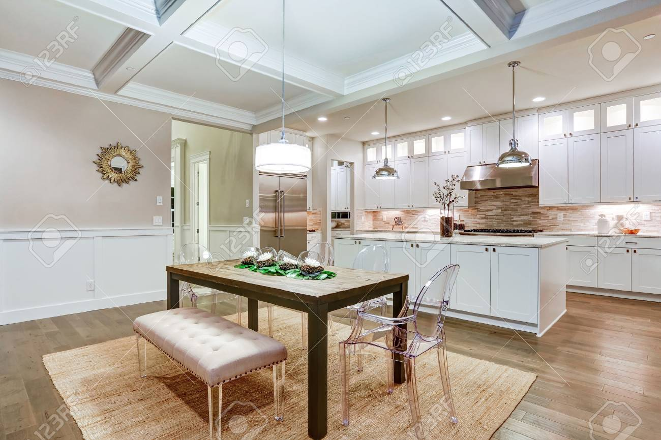 Lovely craftsman style dining space with coffered cealing over..