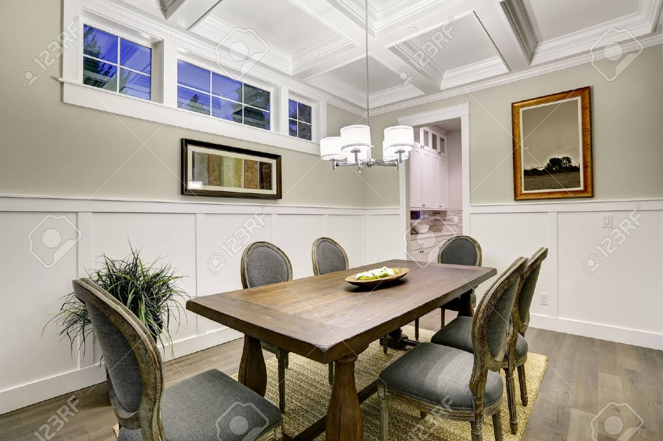 Lovely craftsman style dining room with coffered cealing over..
