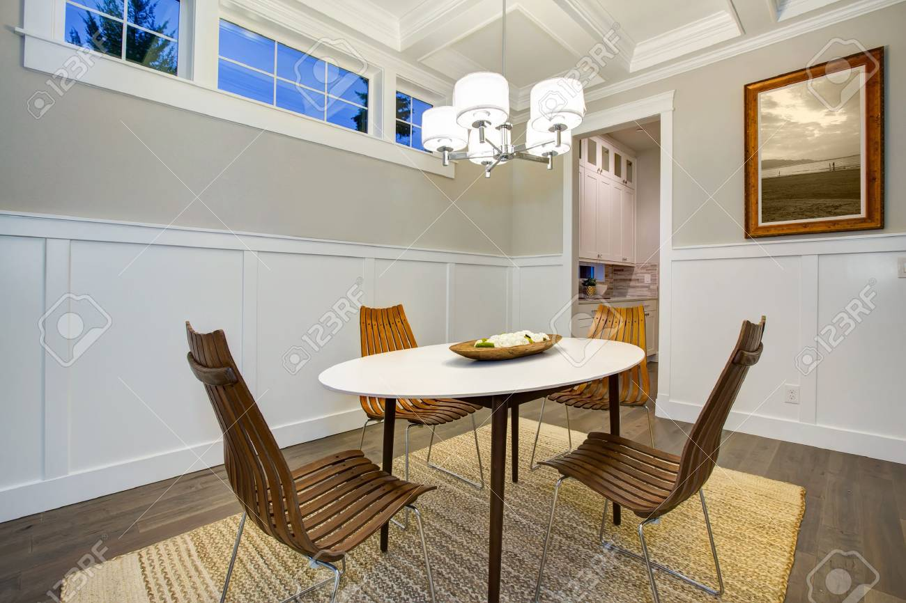 Lovely Craftsman Style Dining Room With Coffered Cealing Over Modern Oval Dining  Table Surrounded By Bentwood