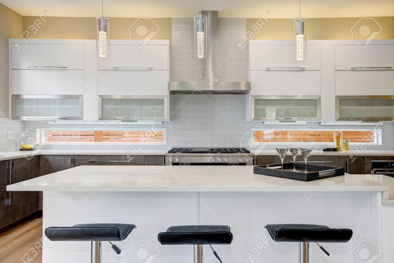 Luxury Kitchen Accented With Large Kitchen Island Topped With