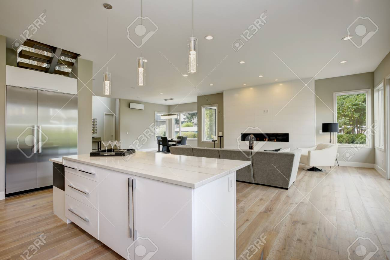 Luxury kitchen accented with large kitchen island topped with..