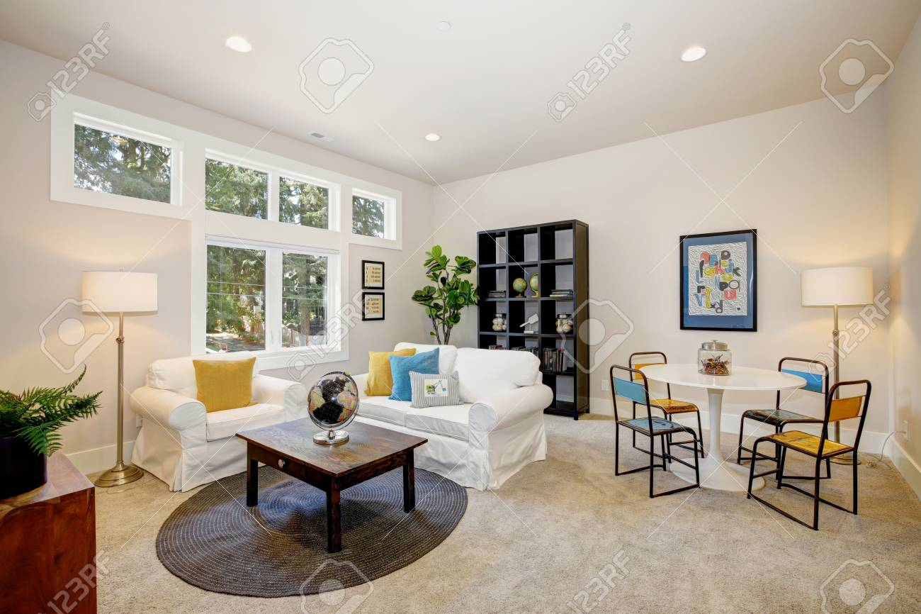 Terrific Family Room And Playroom Features Play Table White Slipcovered Dailytribune Chair Design For Home Dailytribuneorg