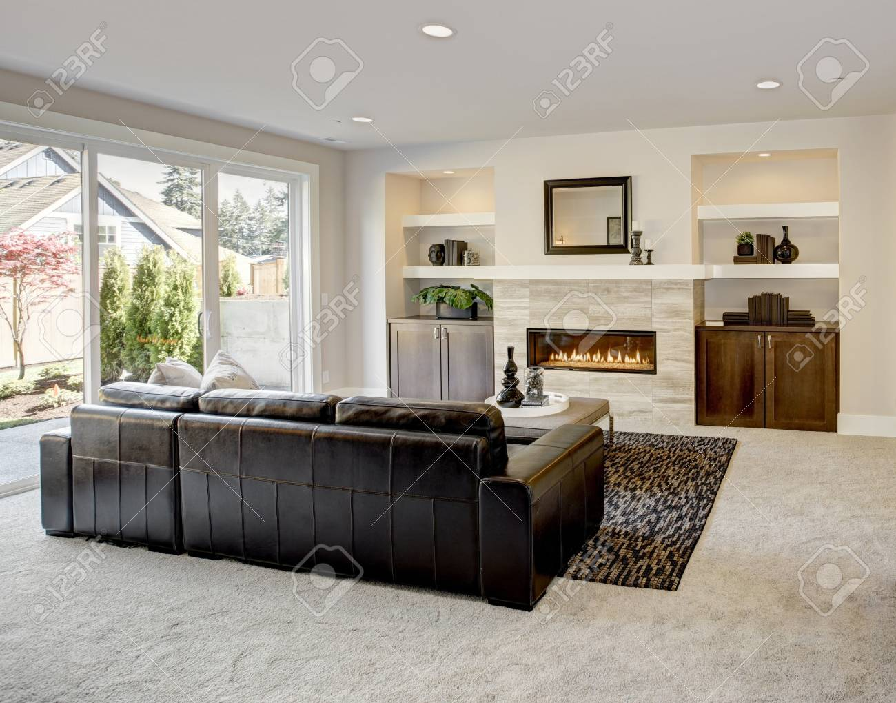 Family Room Design With Traditional Fireplace Framed By Built In Shelves  And Cabinets. Northwest,