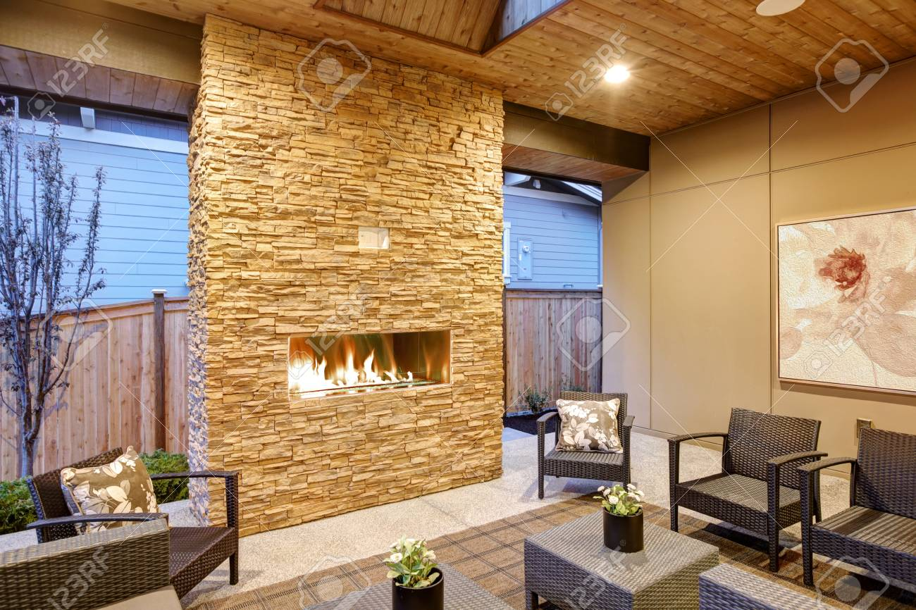 Dreamy Outdoor Covered Patio With Stone Fireplace A Beadboard