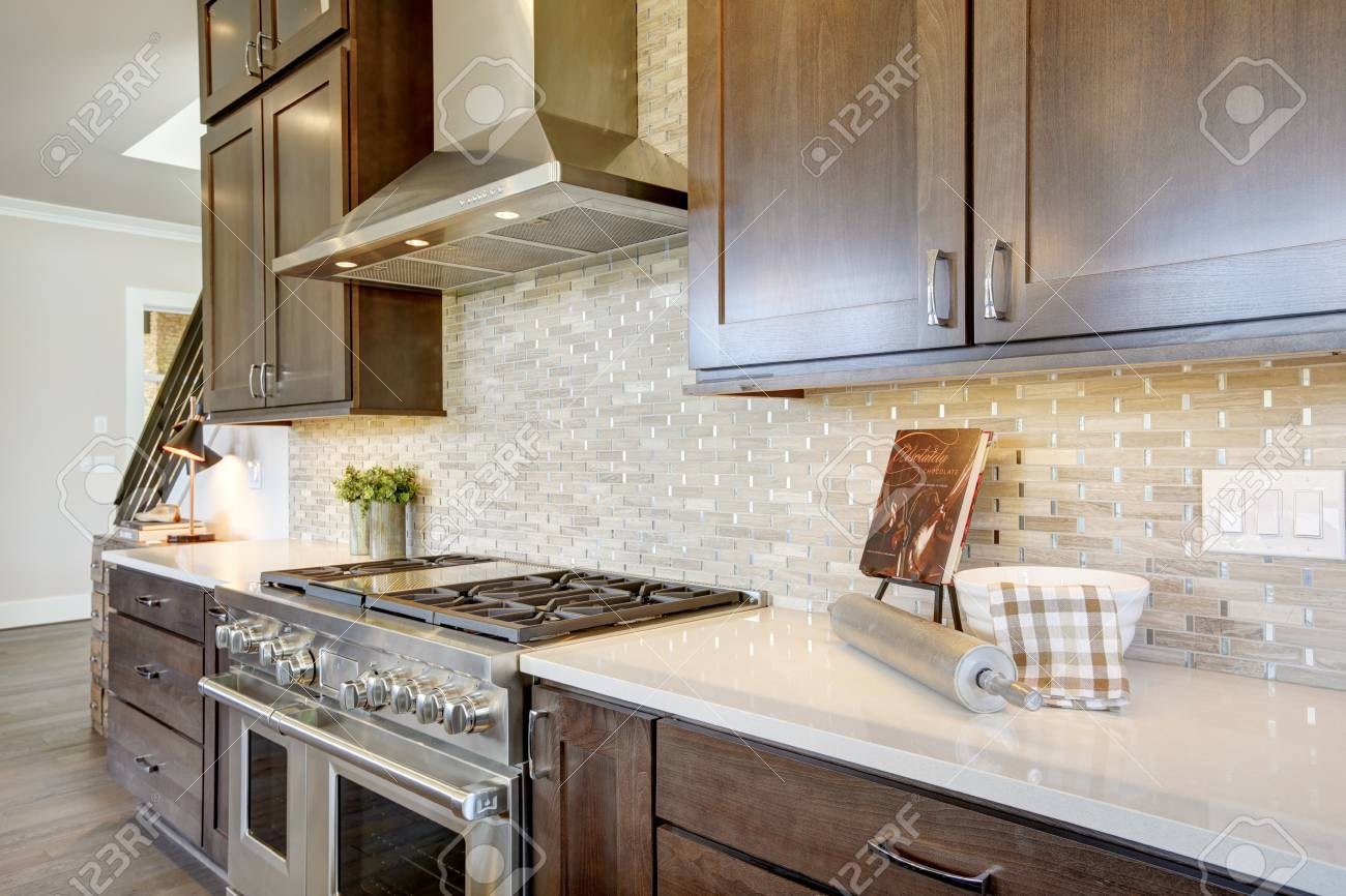 - Luxury Kitchen With Stainless Steel Hood Paired With Mosaic