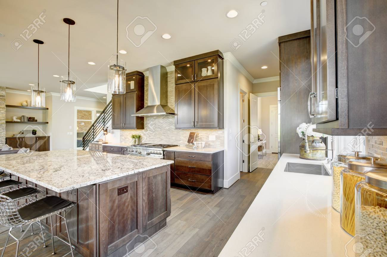 Luxury Kitchen Accented With Large Granite Kitchen Island Taupe