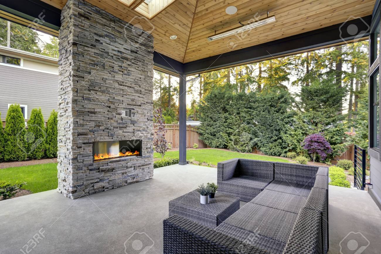 New Modern Home Features A Backyard With Covered Patio Accented ...