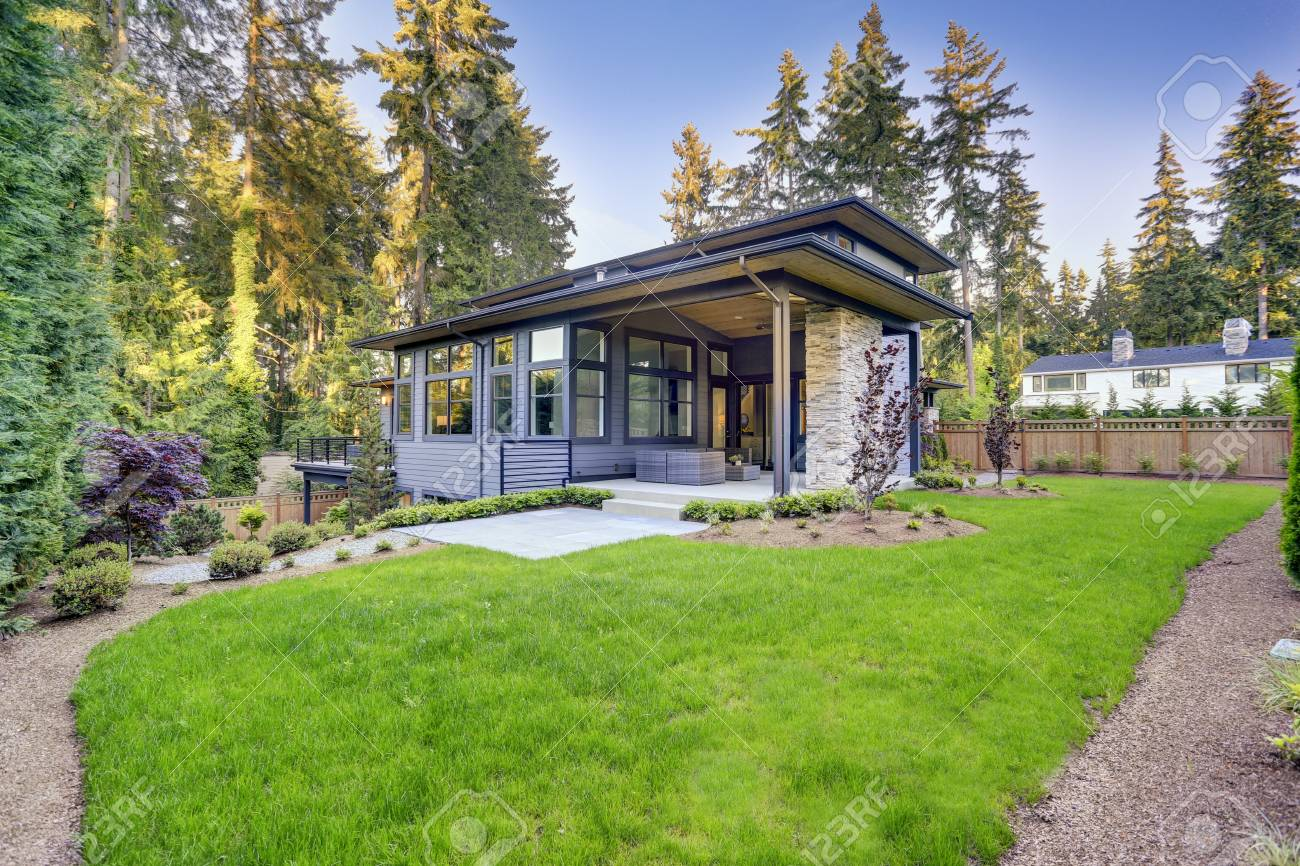 New Modern Home Features A Backyard With Luxurious Covered Patio ...