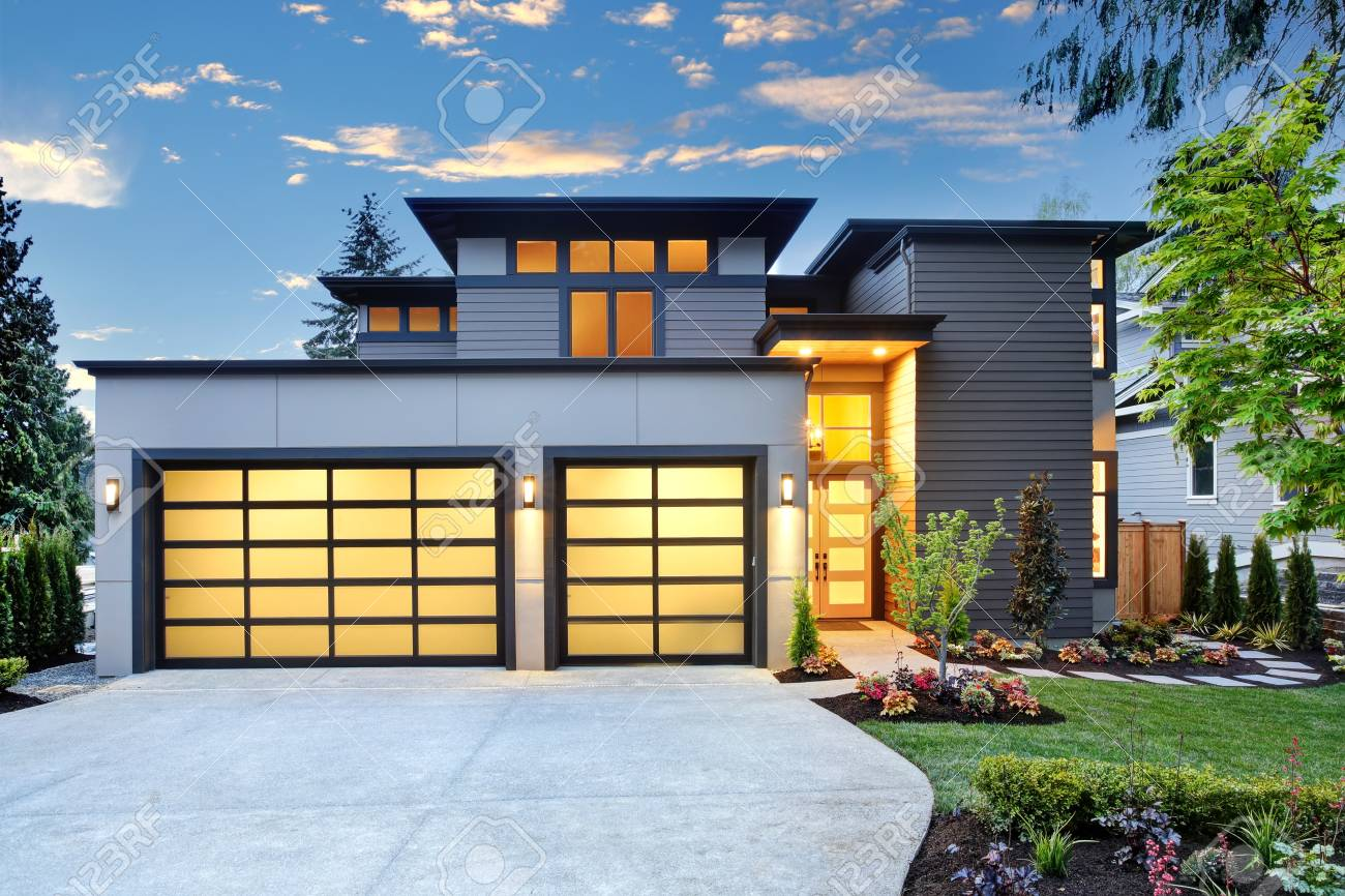 Beautiful Exterior Of Contemporary Home With Two Car Garage Spaces ...
