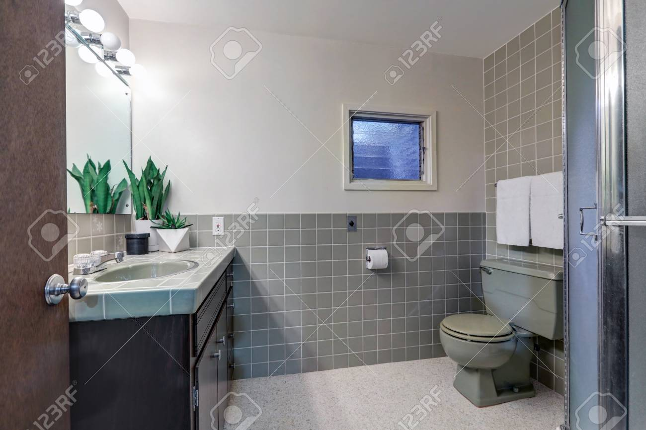 Contemporary Bathroom Features Soft Gray Walls On Top Half Of