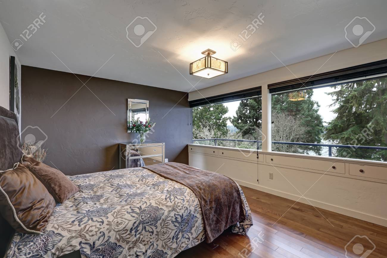 Bedroom With Grey Accent Wall Framing Mirrored Cabinet Topped Stock Photo Picture And Royalty Free Image Image 89871627