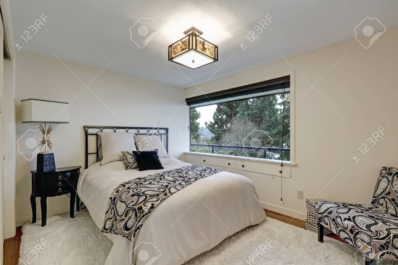 White Bedroom Furnished With Iron Bed Half Moon Black Nightstand