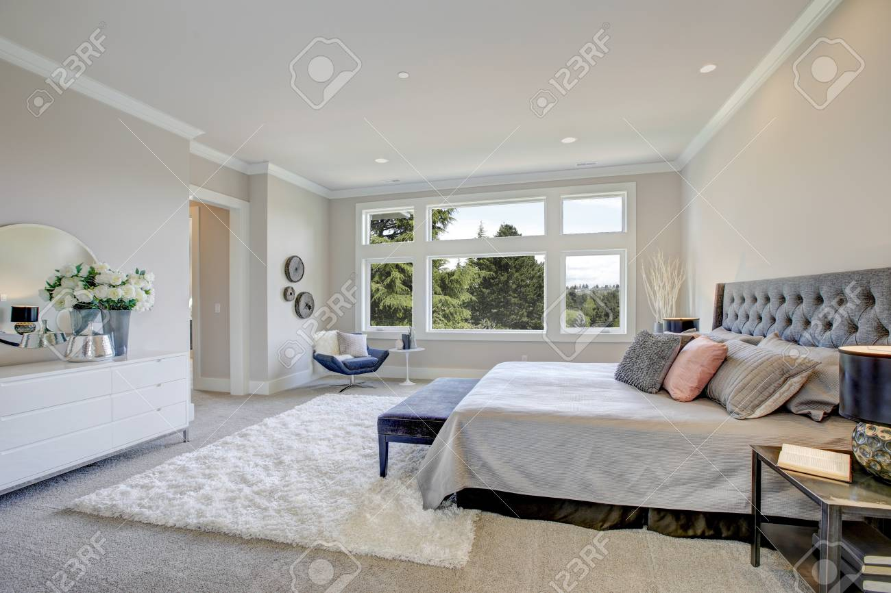 Light Filled Bedroom Boasts A King Size Bed With Tufted Headboard Stock Photo Picture And Royalty Free Image Image 89909964