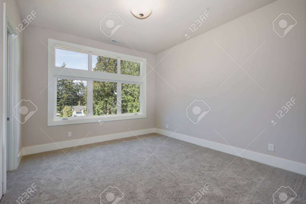 Home Interior Empty Room With Gray Carpet Flooring Light Gray Stock Photo Picture And Royalty Free Image Image 89974042
