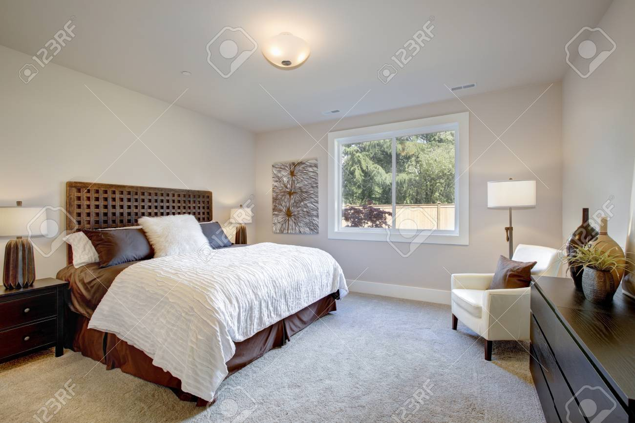 Light Filled Bedroom Boasts A King Size Bed With Wood Headboard Stock Photo Picture And Royalty Free Image Image 90100067