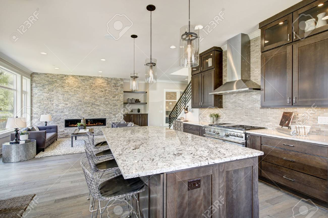 - Luxury Kitchen Accented With Large Granite Kitchen Island, Taupe