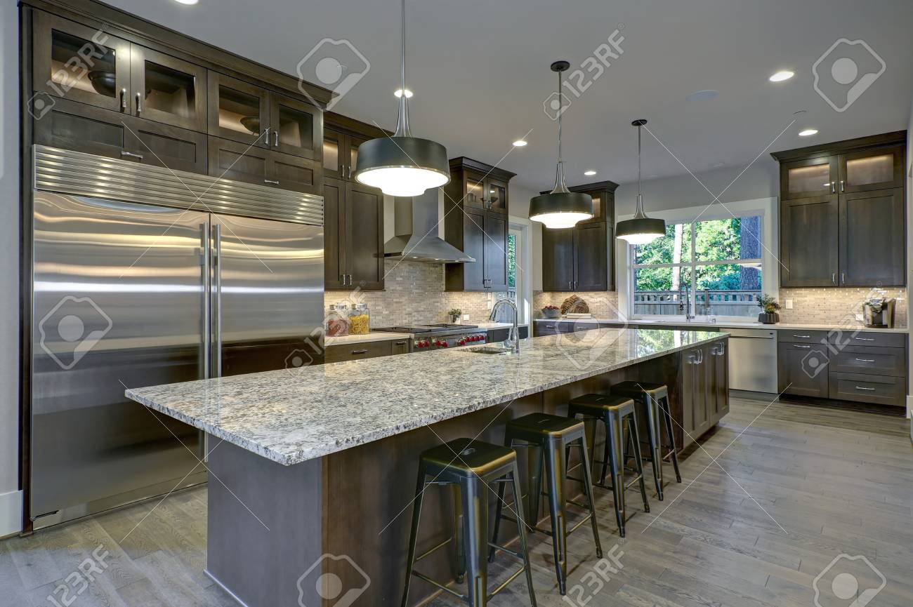 Modern kitchen with brown kitchen cabinets, oversized kitchen..