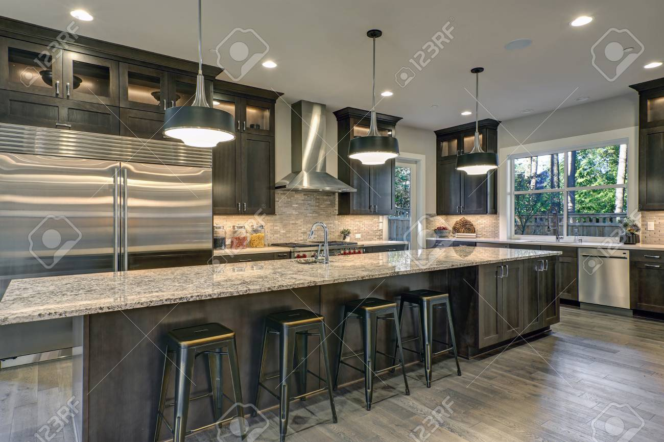 Modern Kitchen With Brown Kitchen Cabinets Oversized Kitchen Stock Photo Picture And Royalty Free Image Image 93644522