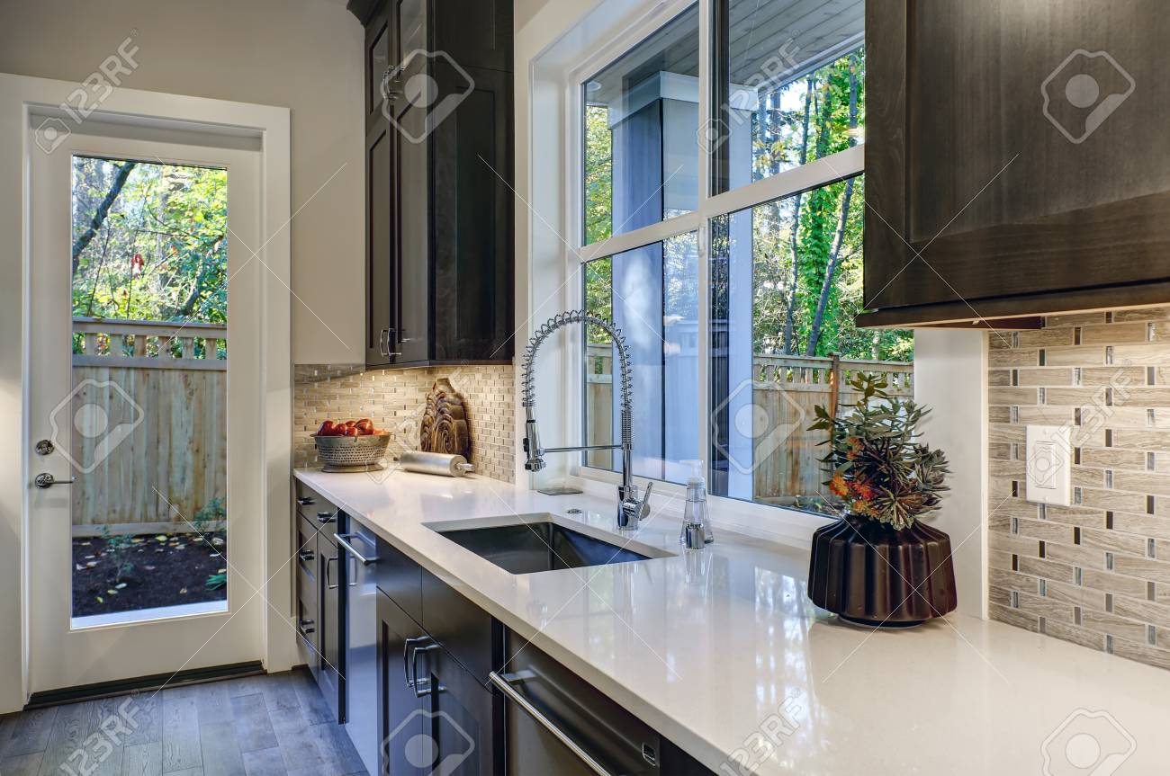 - Contemporary Kitchen Design With Brown Kitchen Cabinets Paired