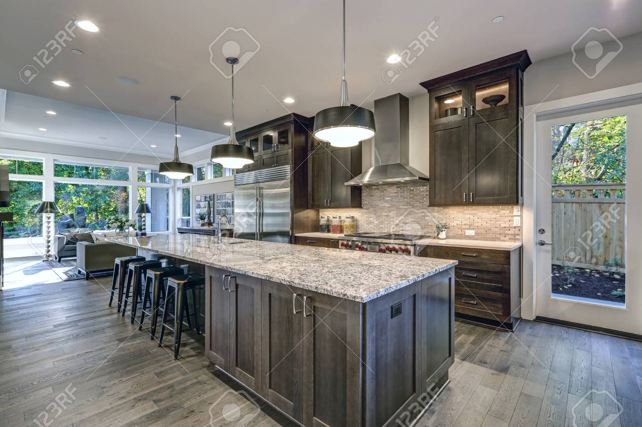 - Modern Kitchen With Brown Kitchen Cabinets, Oversized Kitchen