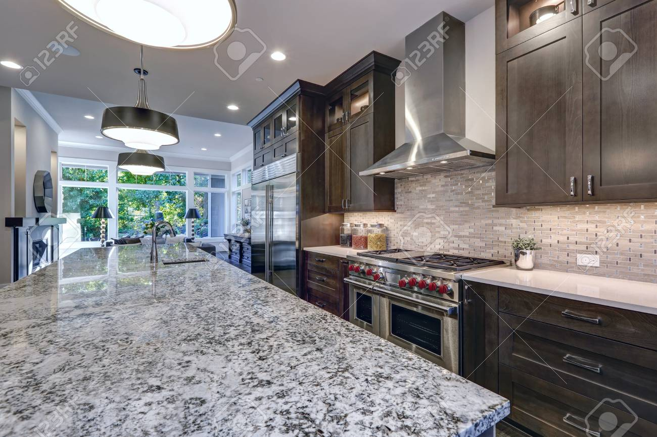 Modern Kitchen With Brown Kitchen Cabinets Oversized Kitchen Stock Photo Picture And Royalty Free Image Image 93644529
