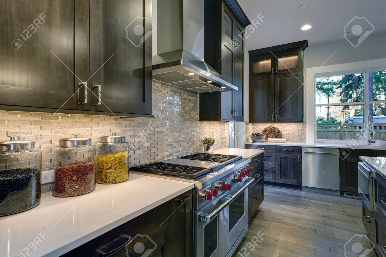 - Modern Kitchen With Brown Kitchen Cabinets Paired With White