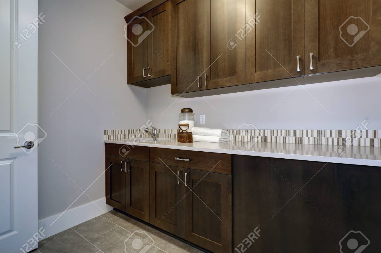 laundry room interior features blue and grey walls framing brown rh 123rf com gray kitchen walls with dark brown cabinets Light Gray Kitchen Walls