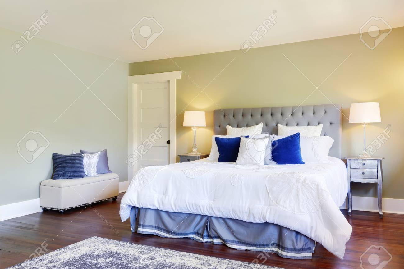 Luxurious Master Bedroom With Green Walls And White And Blue.. Stock ...