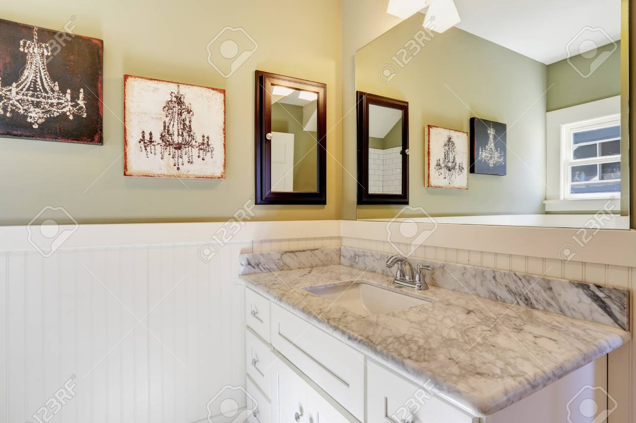 Picture of: White And Green Bathroom With A Carrera Marble Topped Vanity Stock Photo Picture And Royalty Free Image Image 94037920