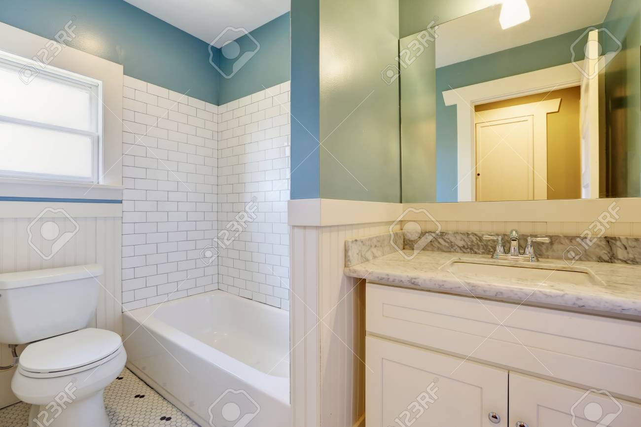 Picture of: White And Blue Bathroom With Vintage Tile And A Carrera Marble Topped Stock Photo Picture And Royalty Free Image Image 94390735
