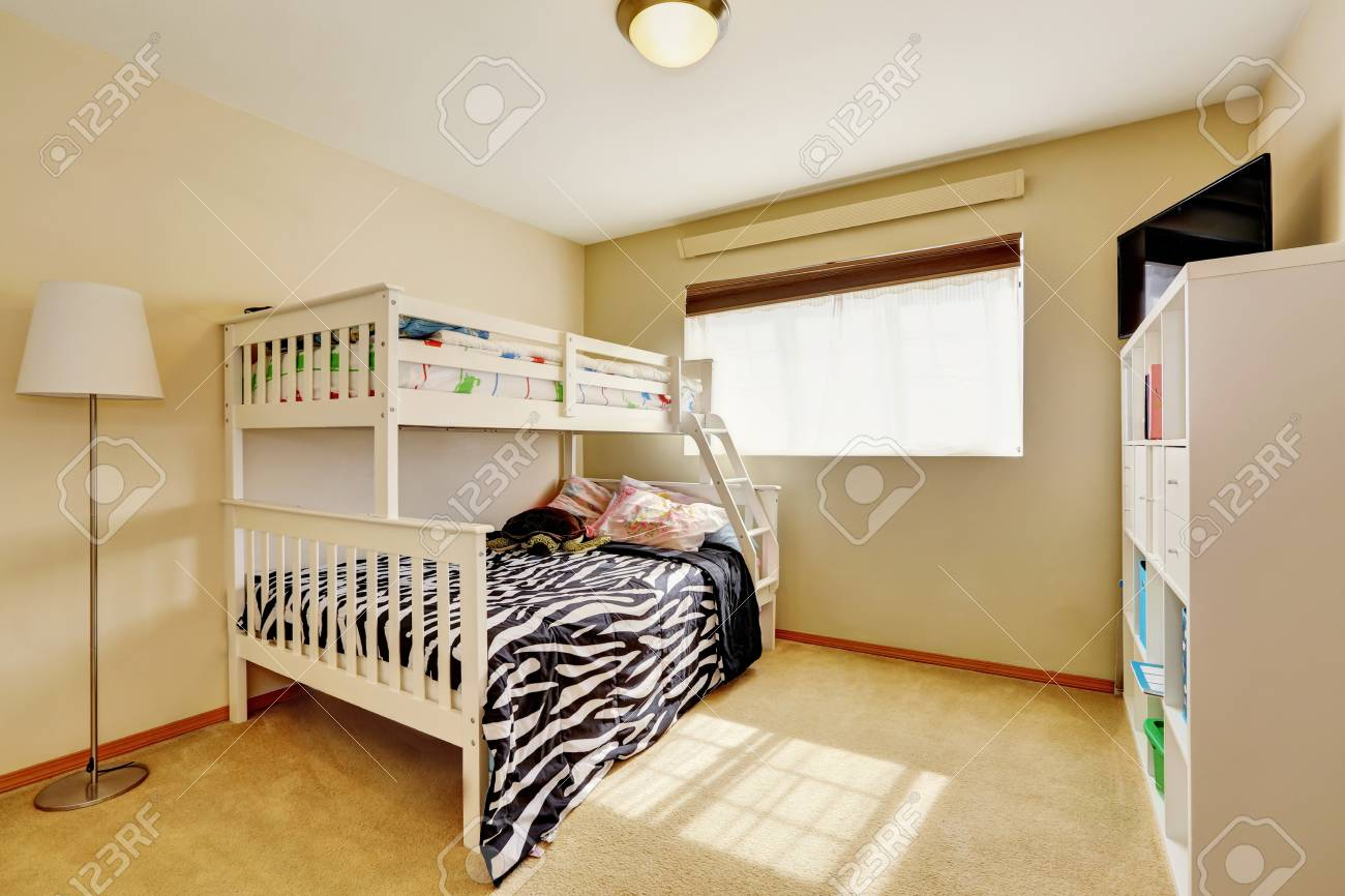 Sunny Beige Kids Room With A Bunk Bed With Built In Ladder And