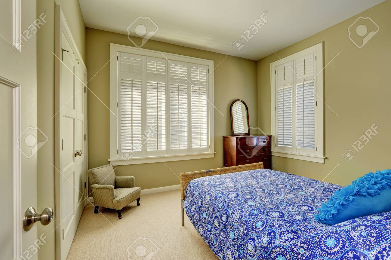 Green Olive Bedroom Interior With Blue Bed Wood Cabinet With