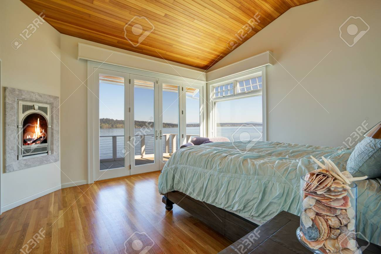Light Spacious Bedroom With Vaulted Plank Ceiling White Walls