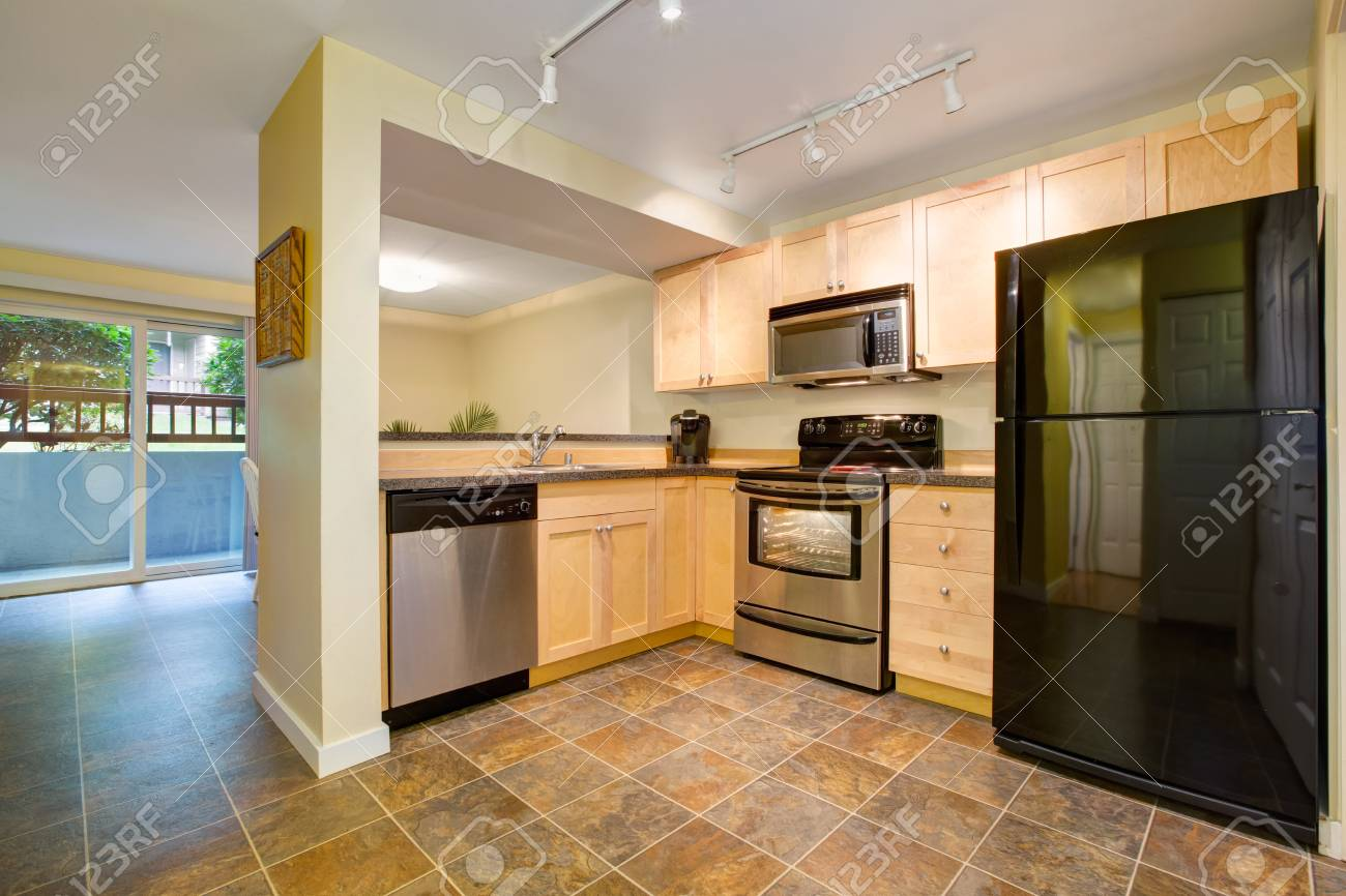 Efficient, compact kitchen design with honey stained kitchen..