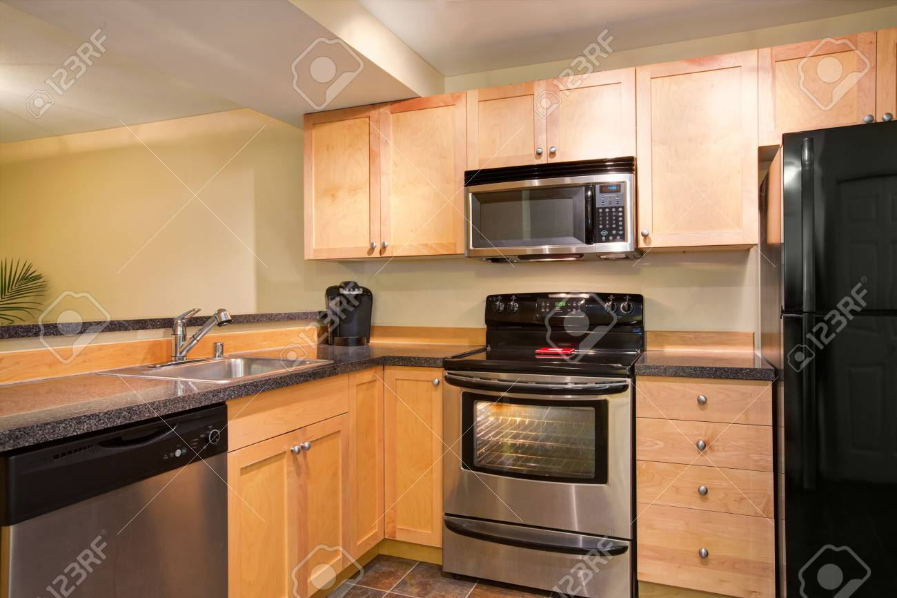 Efficient Compact Kitchen Design With Honey Stained Kitchen Stock