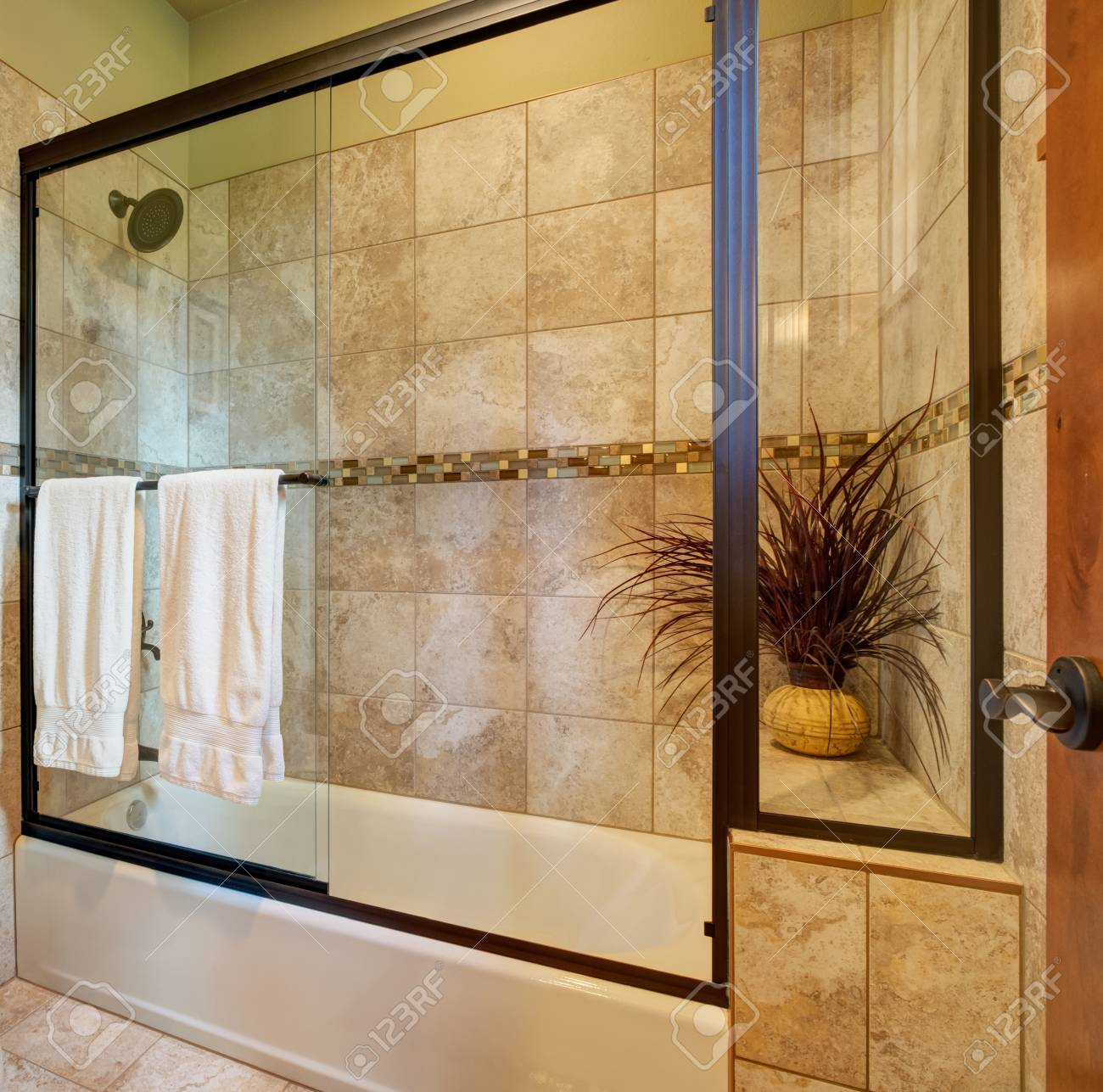 Master Bathroom Interior. Tub And Shower Combo Features Brown ...