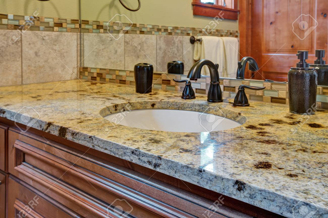 - Master Bathroom Interior: Bathroom Vanity Topped With Granite