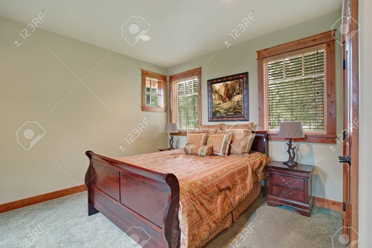 Neutral Bedroom Interior In Brown Tones With King Size Bed And Pale Green  Walls. Northwest