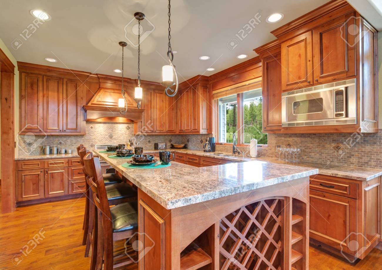 Gourmet Kitchen Boasts A Bar Style Kitchen Island With Built In