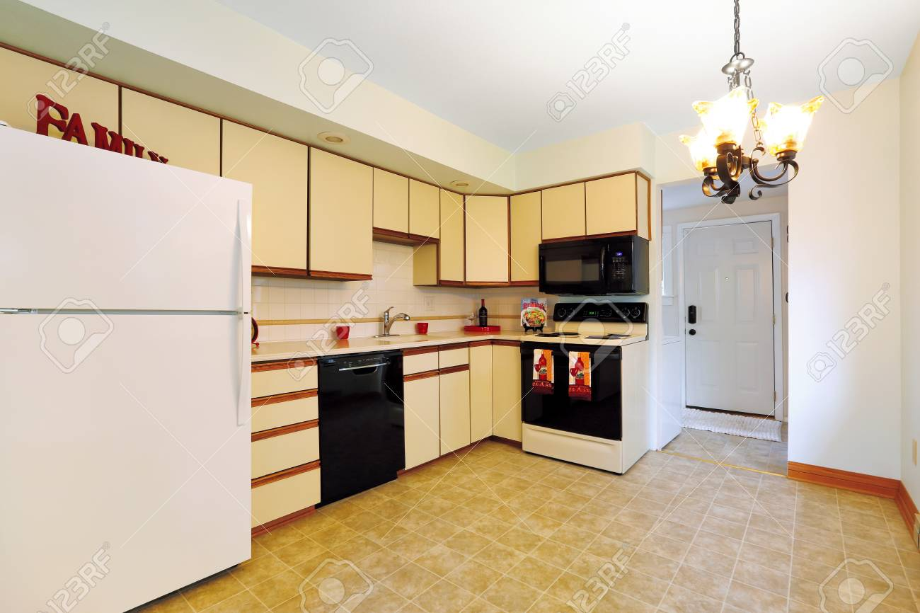 Remodeled Kitchen Room With Cream Cabinets Black Appliances
